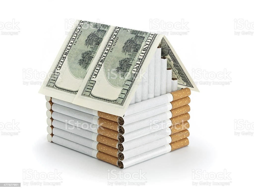 The cigarette house and souvenir dollars royalty-free stock photo