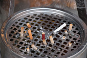 The cigarette stubs in the ashtray.