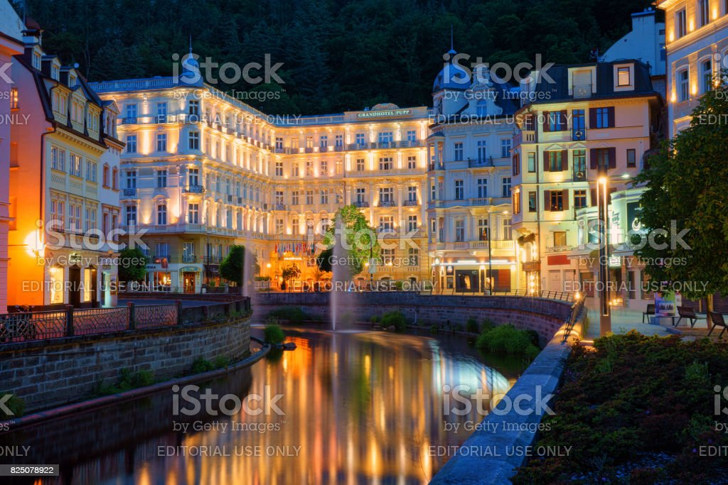 The city light with the reflection during blue hour from the Grand Hotel Pupp stock photo