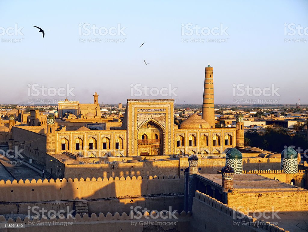 The city of Khiva lit up at sunset stock photo