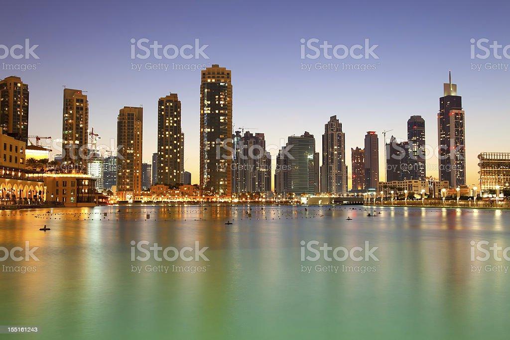 The city skyline at night from Dubai mall royalty-free stock photo