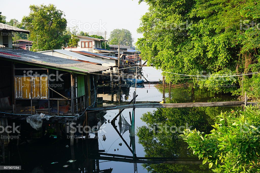 the city's Slums from the river in Bangkok, Thailand. stock photo