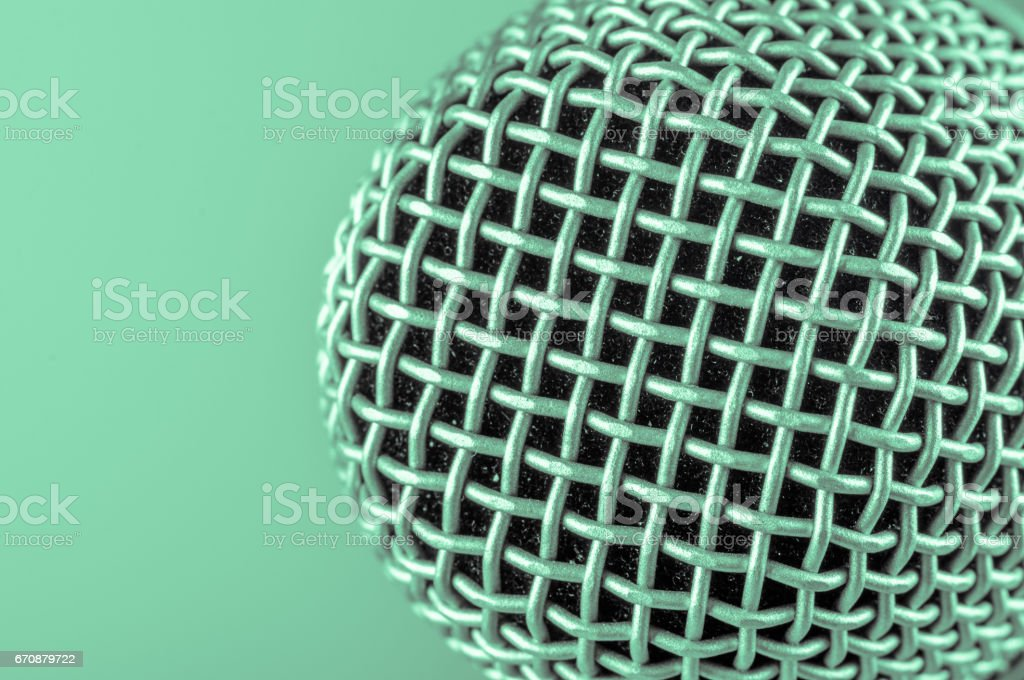 the classic vintage silver microphone on green background stock photo