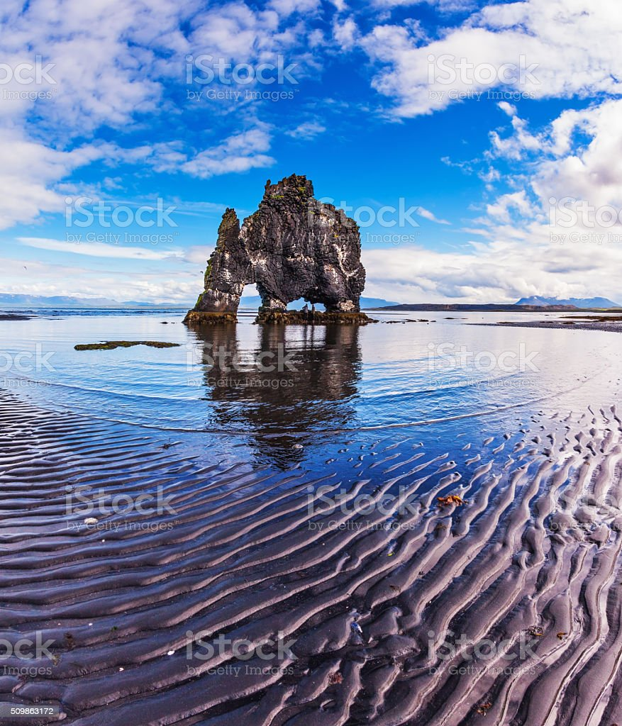 The cliff in Bay during low tide at sunset stock photo