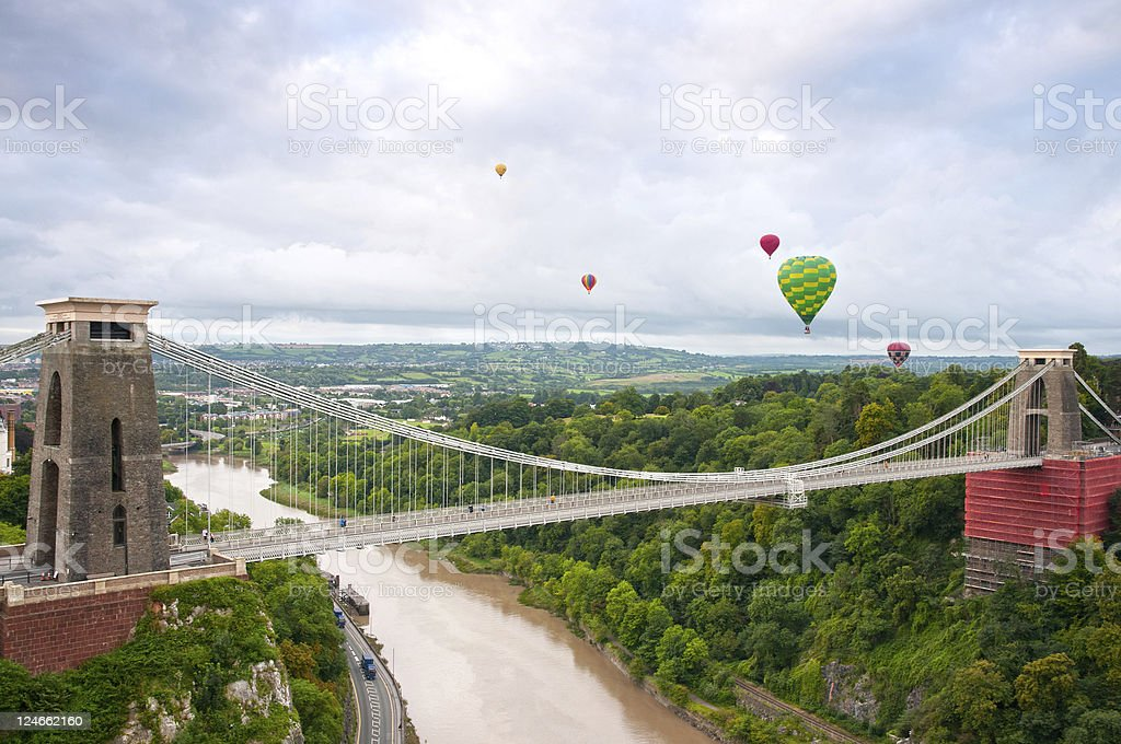 The Clifton Suspension Bridge with several hot air balloons stock photo