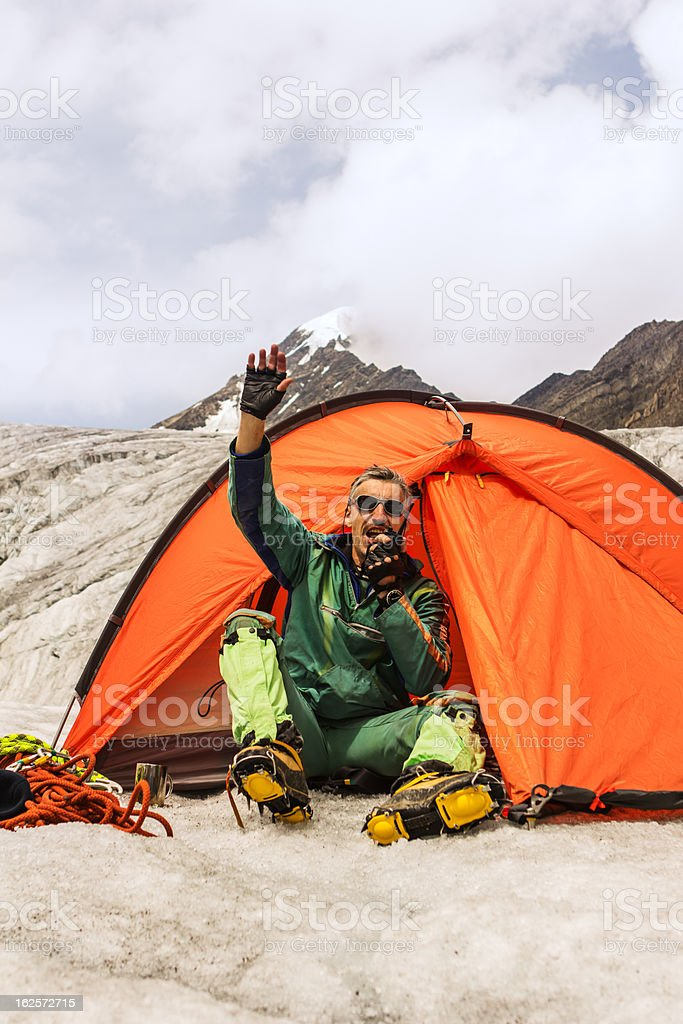 The climber mountain camp in tent stock photo