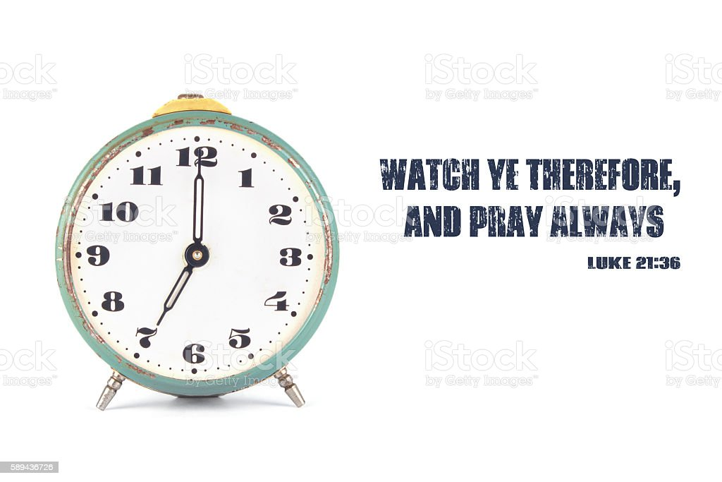 The clock and the words from the Bible stock photo