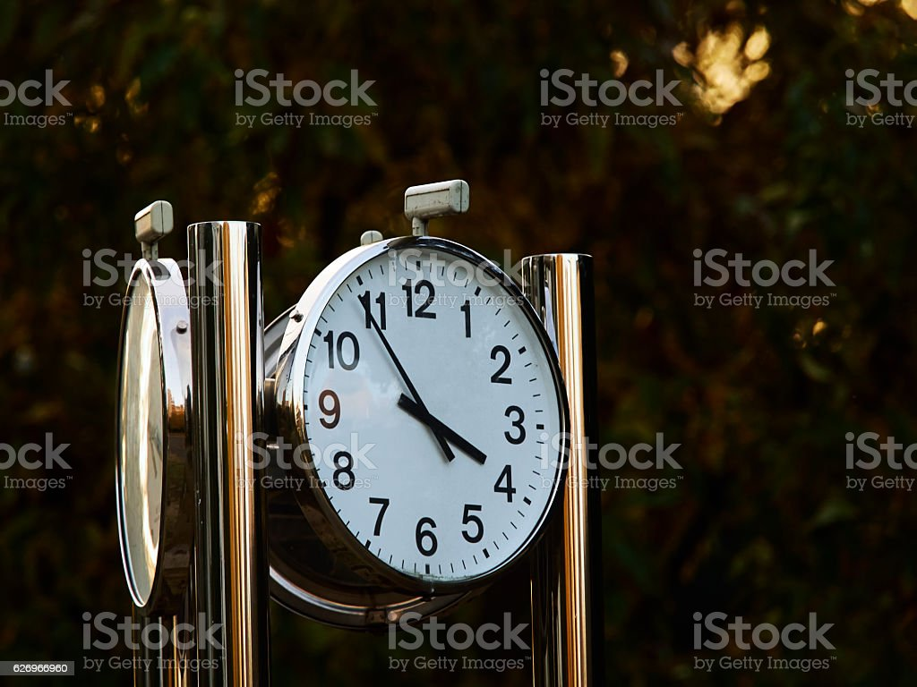 The clock in the park stock photo