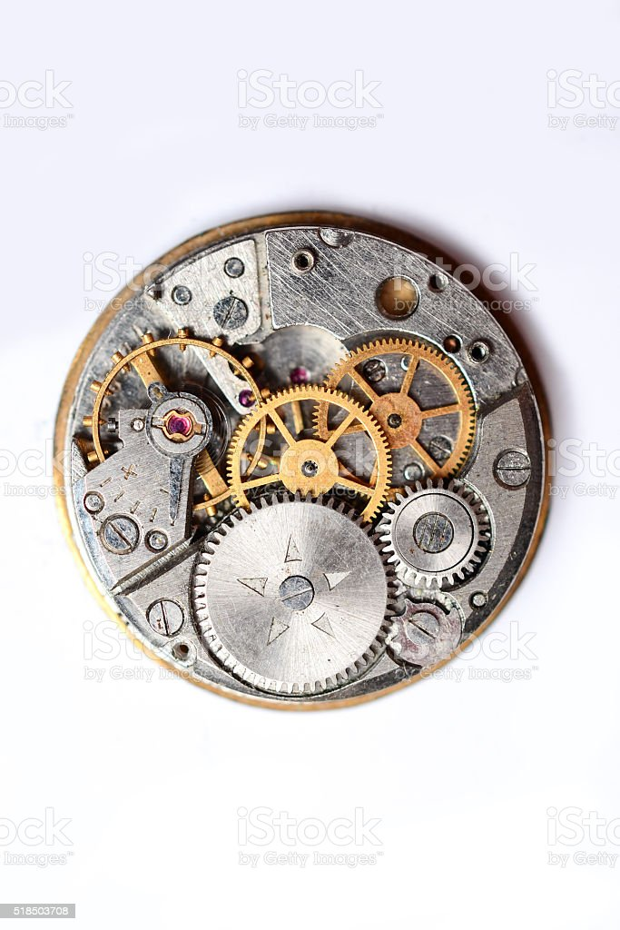 The clock mechanism on a white background stock photo