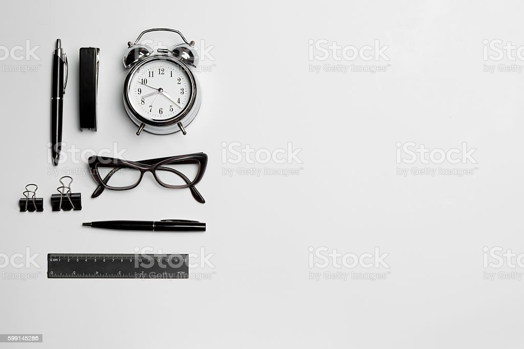 The clock, pen, and glasses on white background stock photo