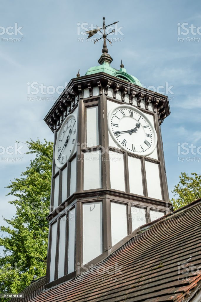 the clock tower with the pointer direction stock photo