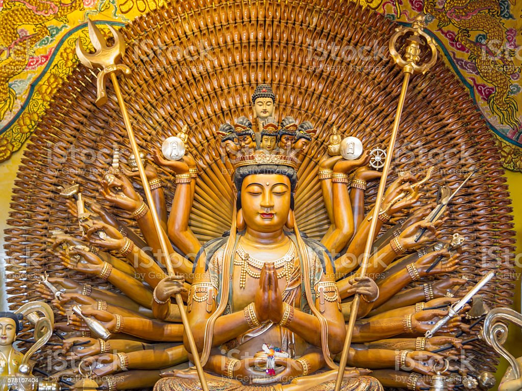 The close up 10 face of Statue of Guanyin stock photo