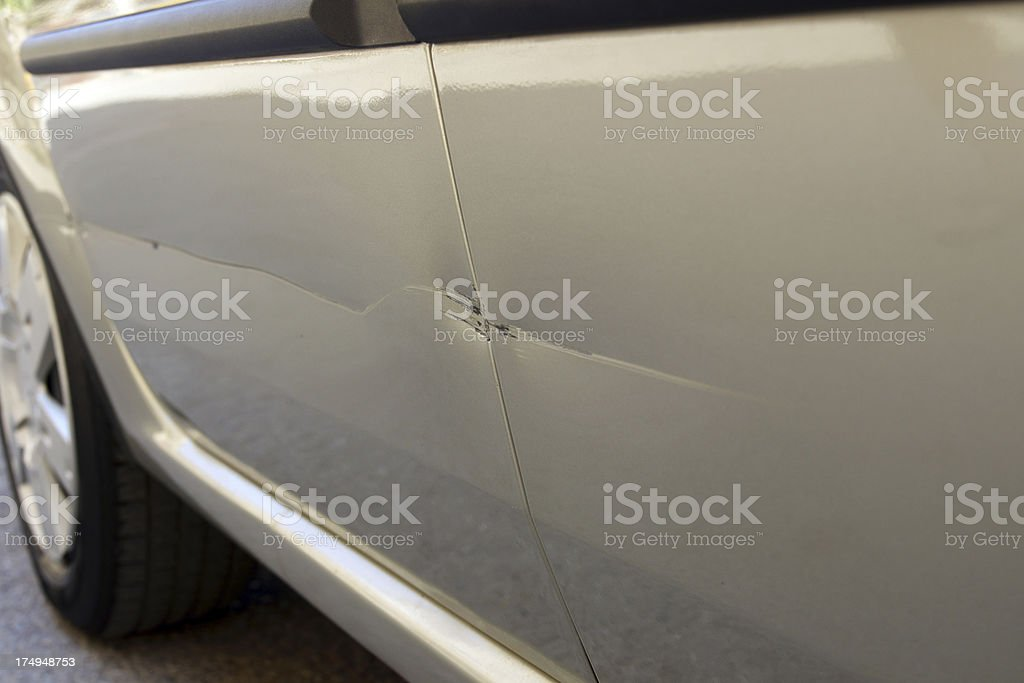 The close up of a scratch on the side of a car royalty-free stock photo