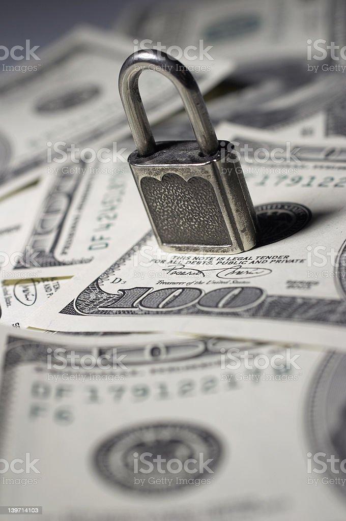 the closed lock on money stock photo