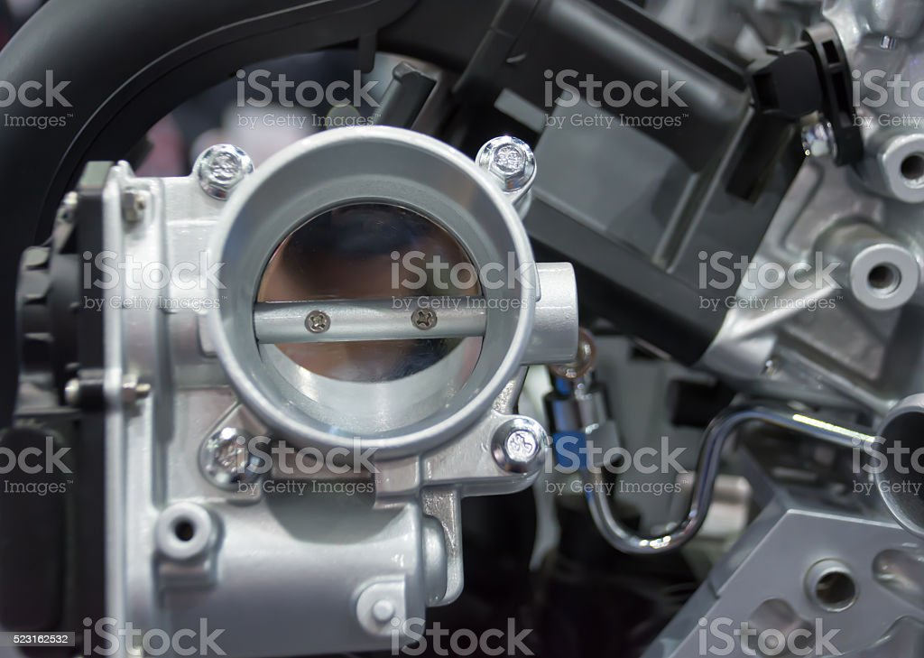 The closed up of throttle body and engine stock photo