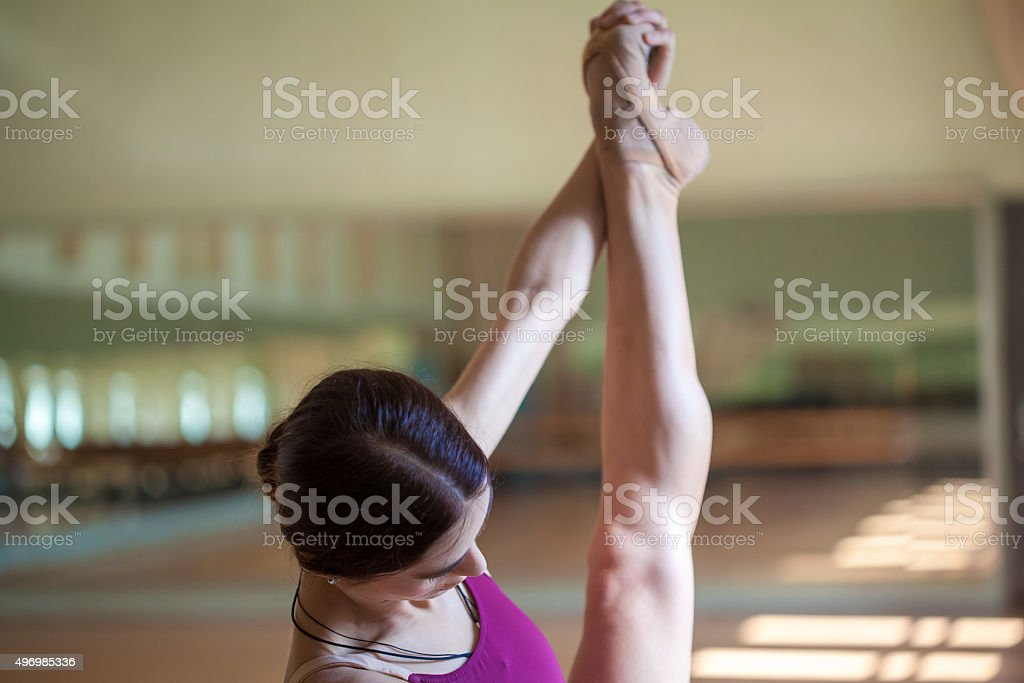 The close-up feet of young ballerina in old pointe stock photo