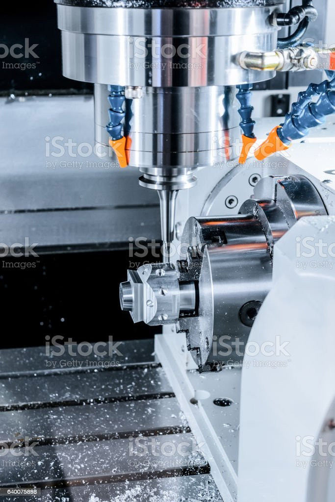 The CNC machine while cutting sample part. stock photo