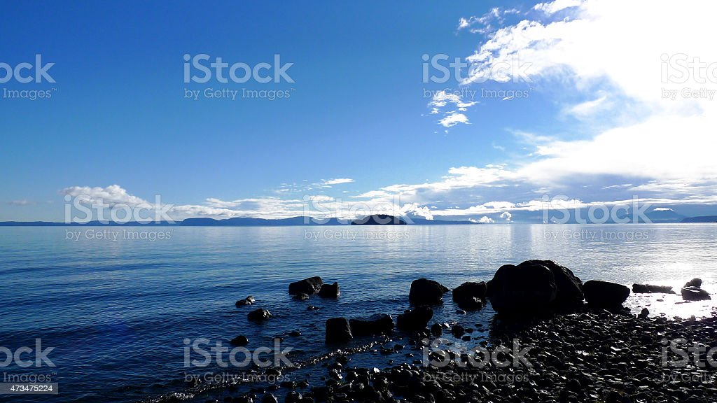 The coast of Lake Taupo in cloudy weather stock photo