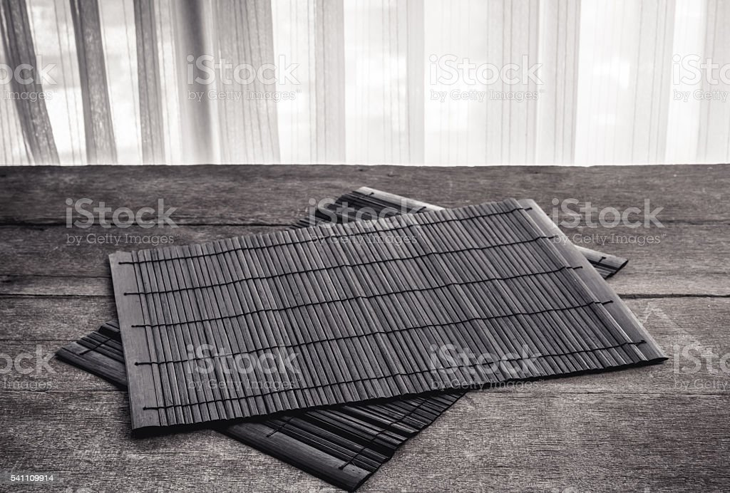 The Coaster, Dark brown bamboo mat stock photo