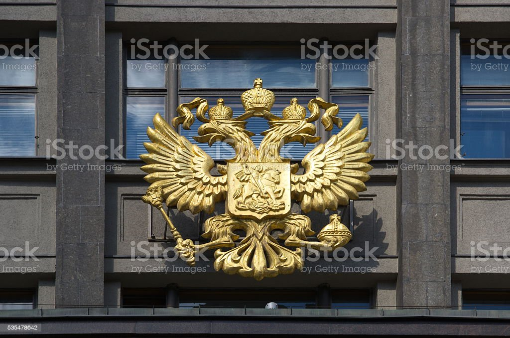 The coat of arms of Russia on the building of the State Duma, Moscow stock photo
