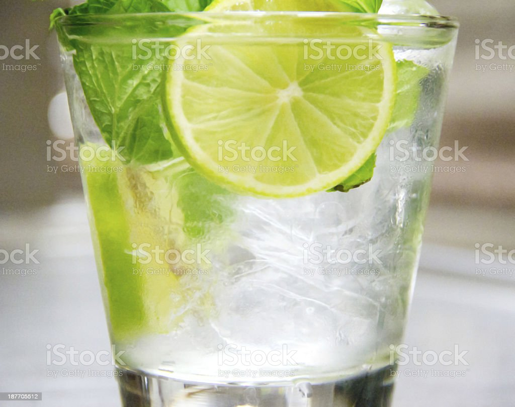 The cocktail Mojito with rum, limes, mint and ice cubes royalty-free stock photo