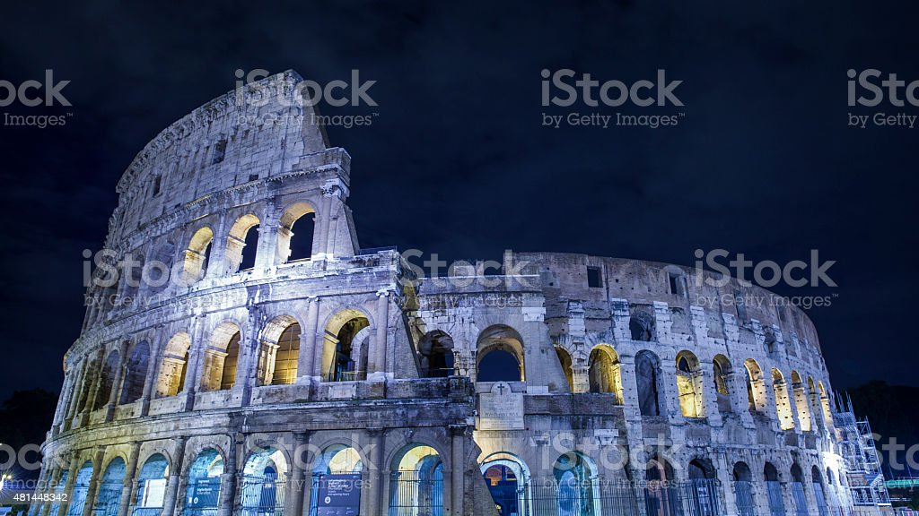 The Coliseum in Rome at night time stock photo