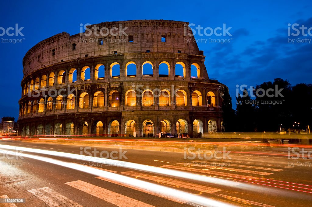 The Coliseum is illuminated at night royalty-free stock photo