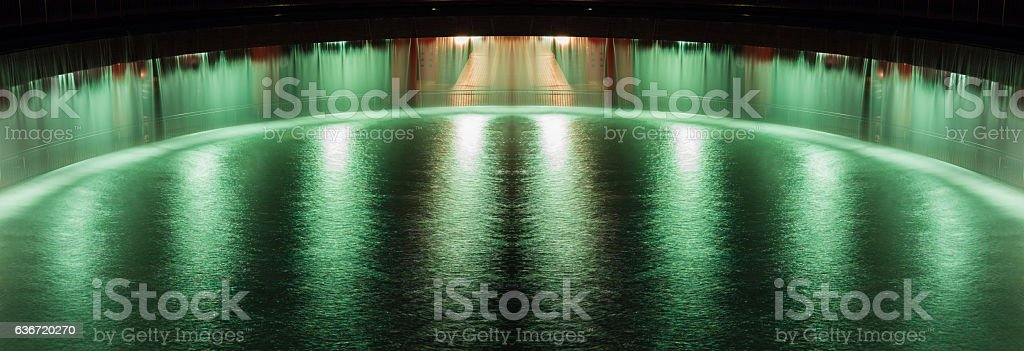 The colorful of fountain on the lake at night. stock photo