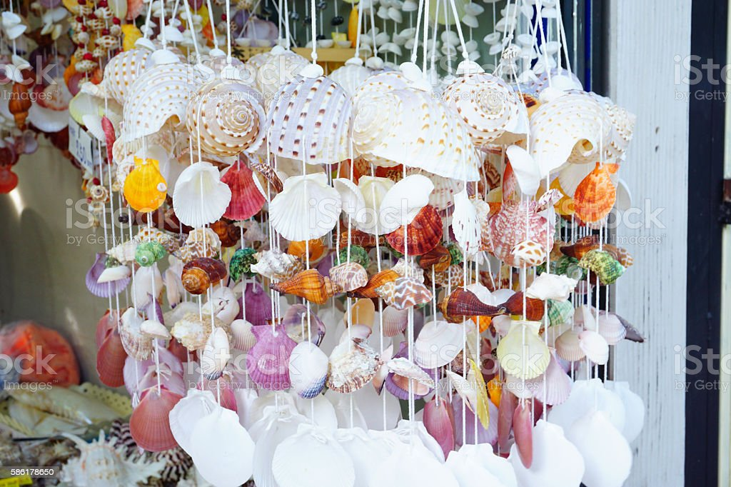 The colorful shell curtain made from shells decoration stock photo