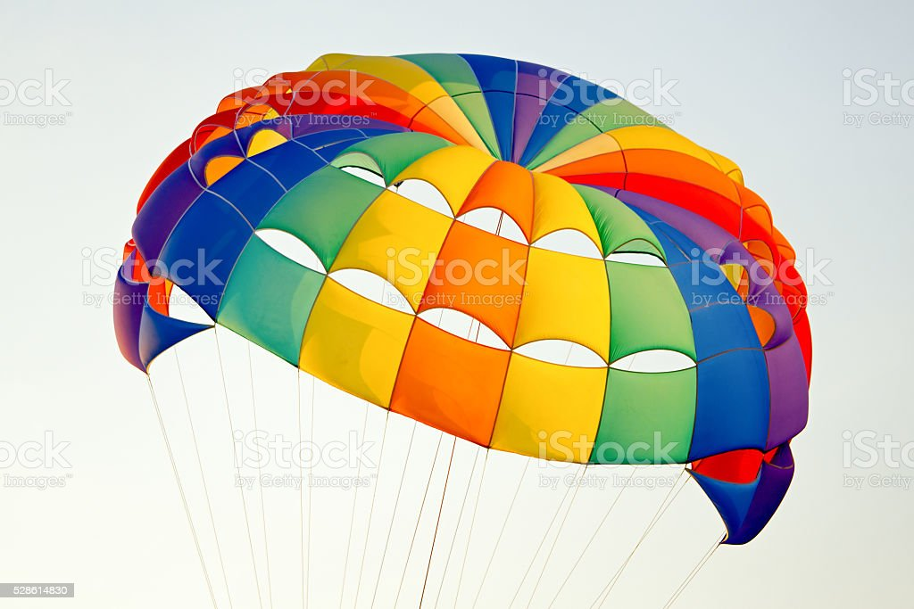 the colorful stripes of parachute in the sky stock photo