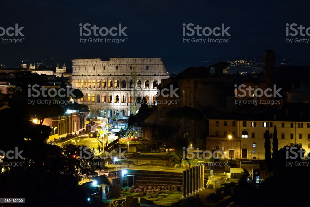 The Colosseum at night stock photo