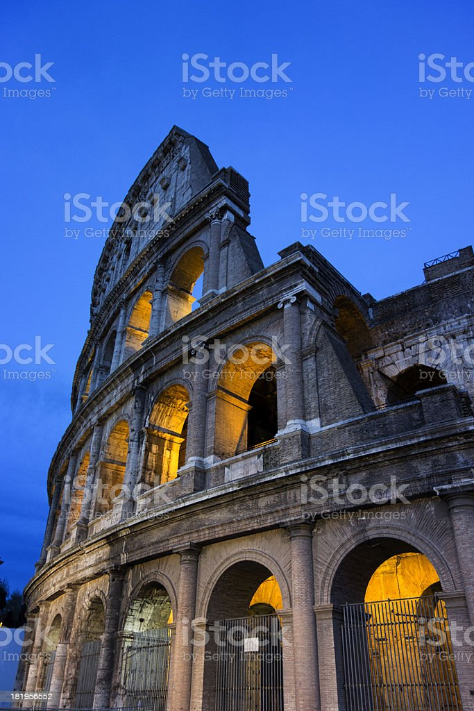 The Colosseum in Rome at dusk royalty-free stock photo