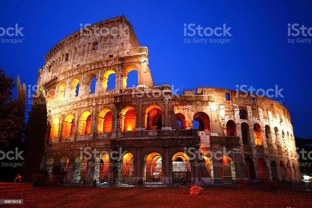 The Colosseum lit up at night in Rome stock photo