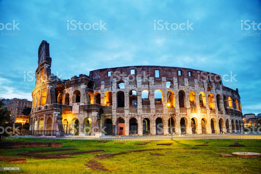 The Colosseum with people at night stock photo