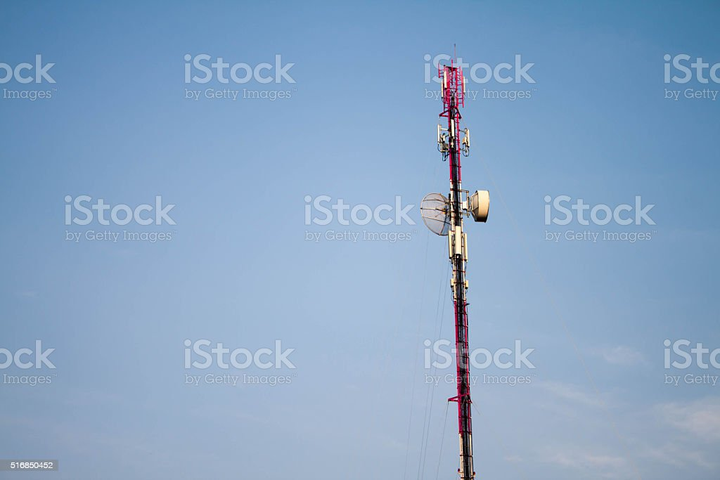 The communication antenna tower with blue sky stock photo
