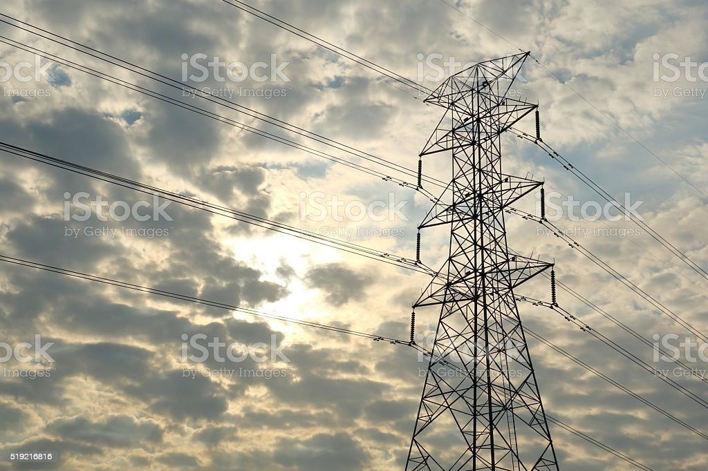 The communications tower with black cloudy sky background. stock photo