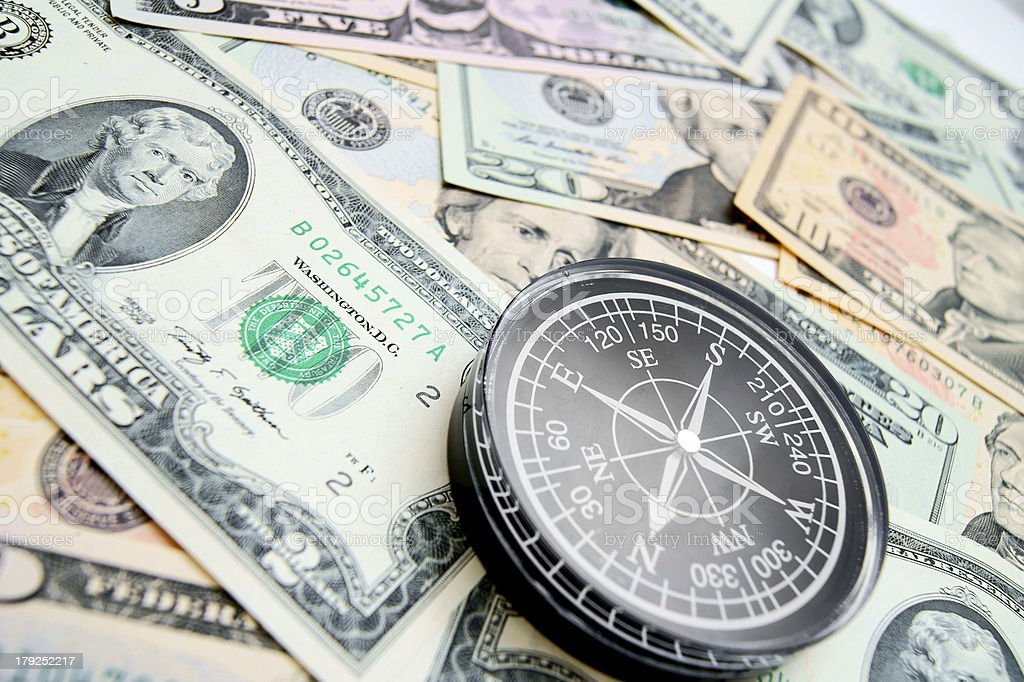 The compass and is a lot of money. royalty-free stock photo