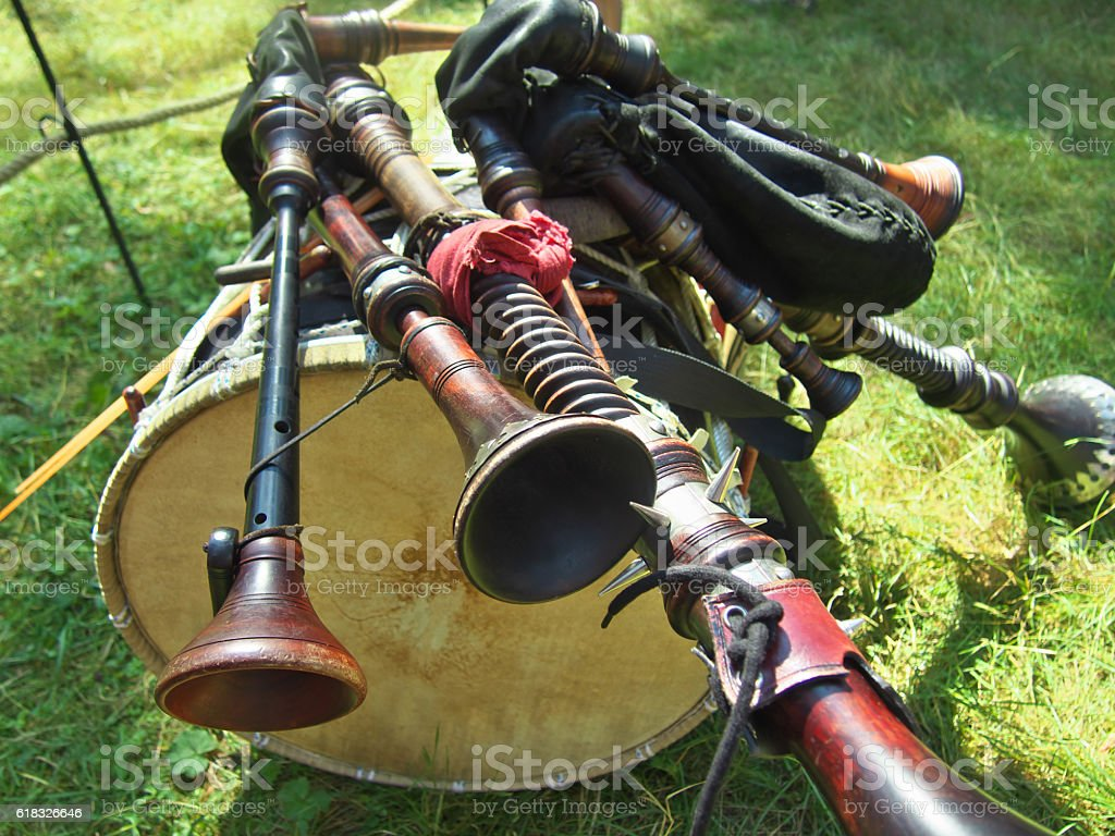 The composition of musical instruments  bagpipes lying on a drum stock photo
