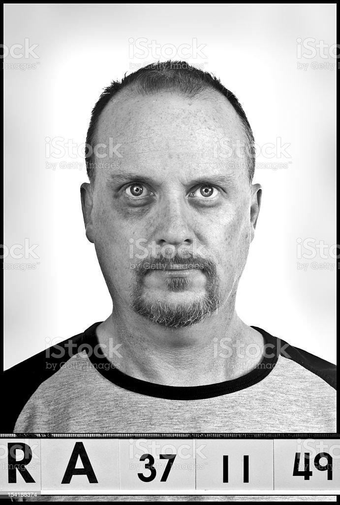The Con mug shot with black eye stock photo