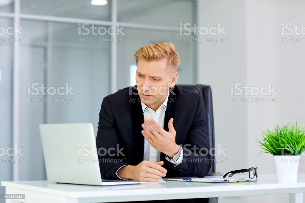 The concept of failure, defeat,  crisis the business. A man sits stock photo