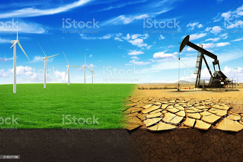 The concept of green energy windmills in a beautiful field. stock photo