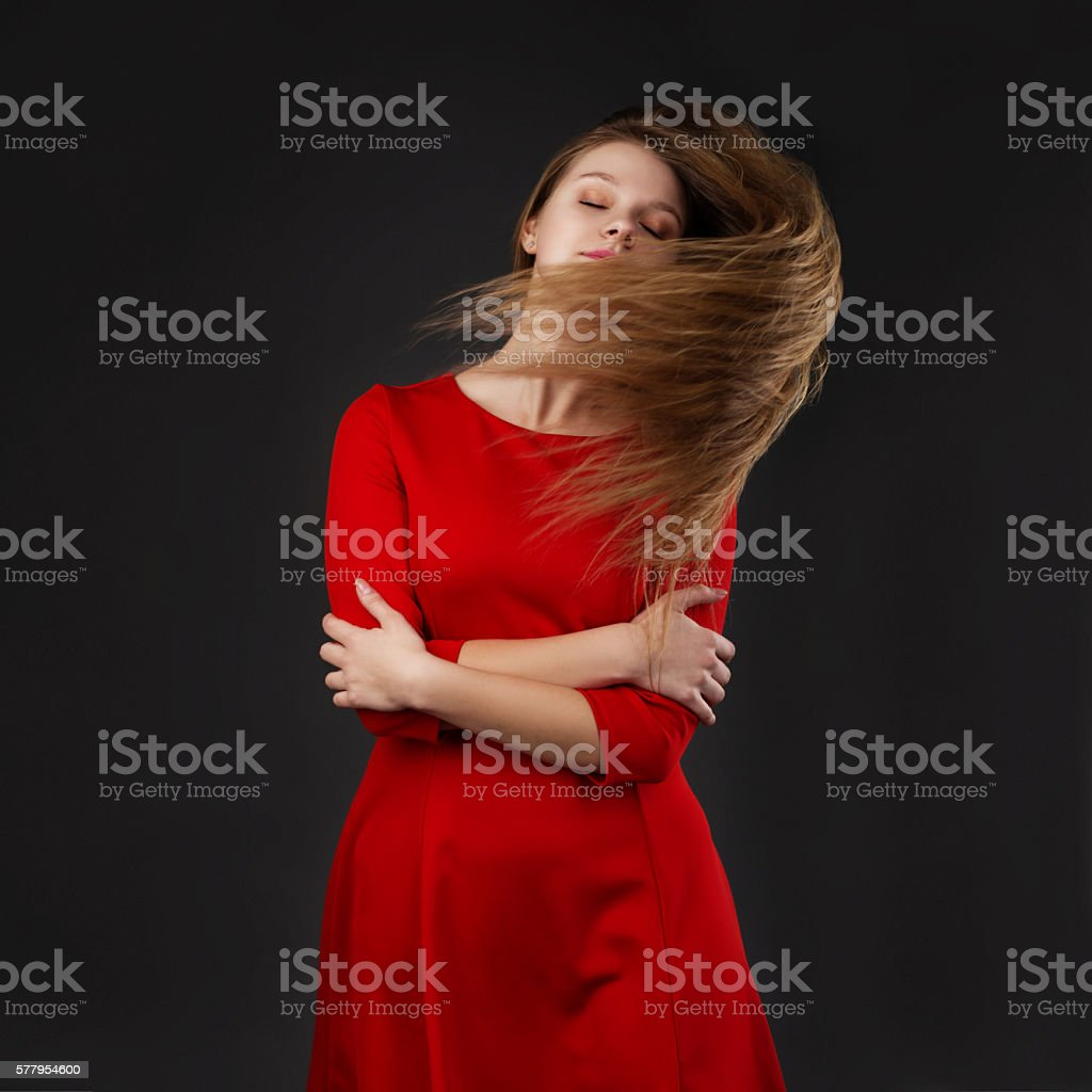 The concept of hair care products. Healthy long shiny hair stock photo