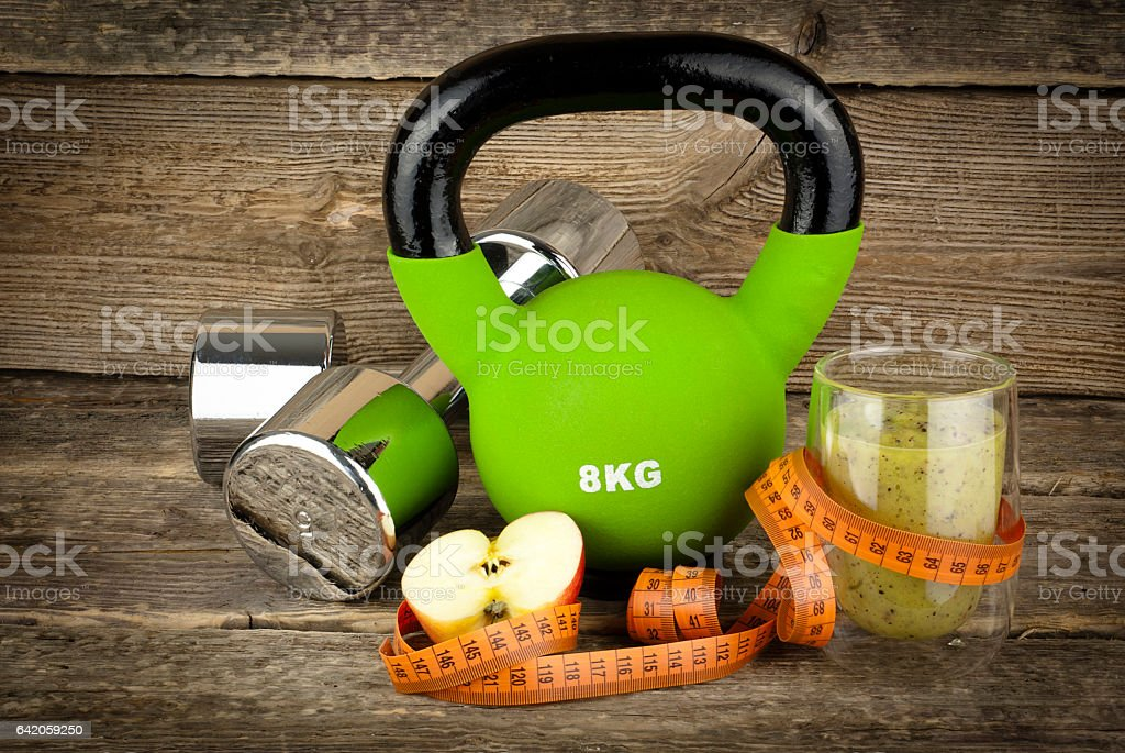 The concept of weight loss, dumbell and kettlebell stock photo