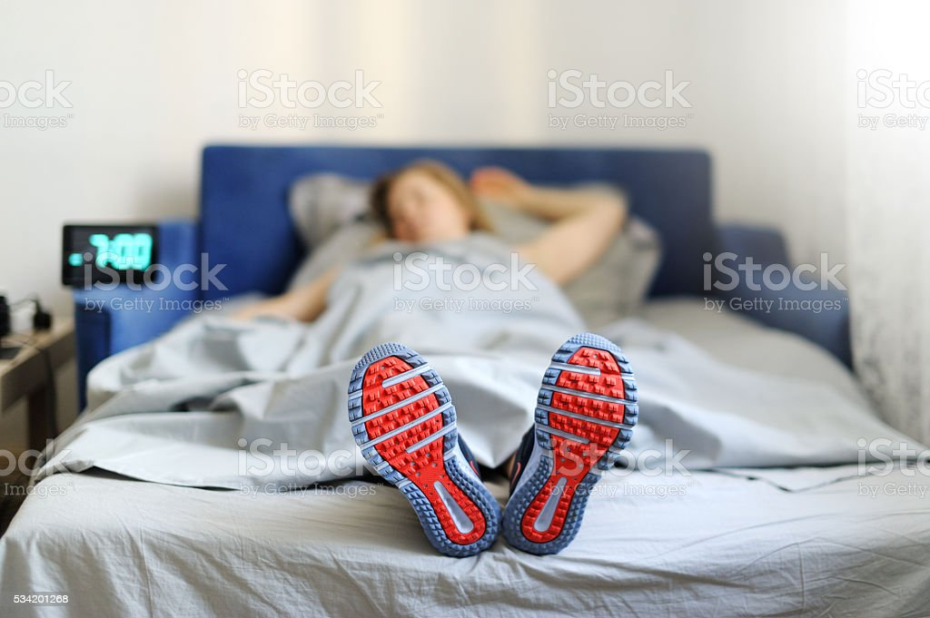 The concept the woman is too lazy to Wake up. stock photo