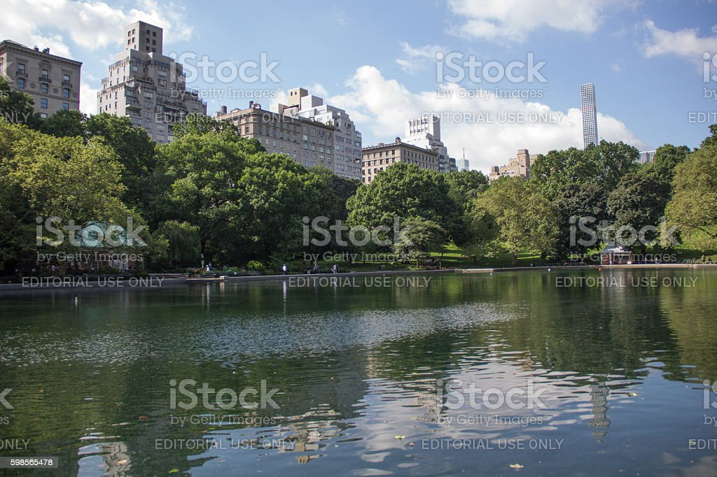 The conservatory pond in Central Park under blue skies stock photo