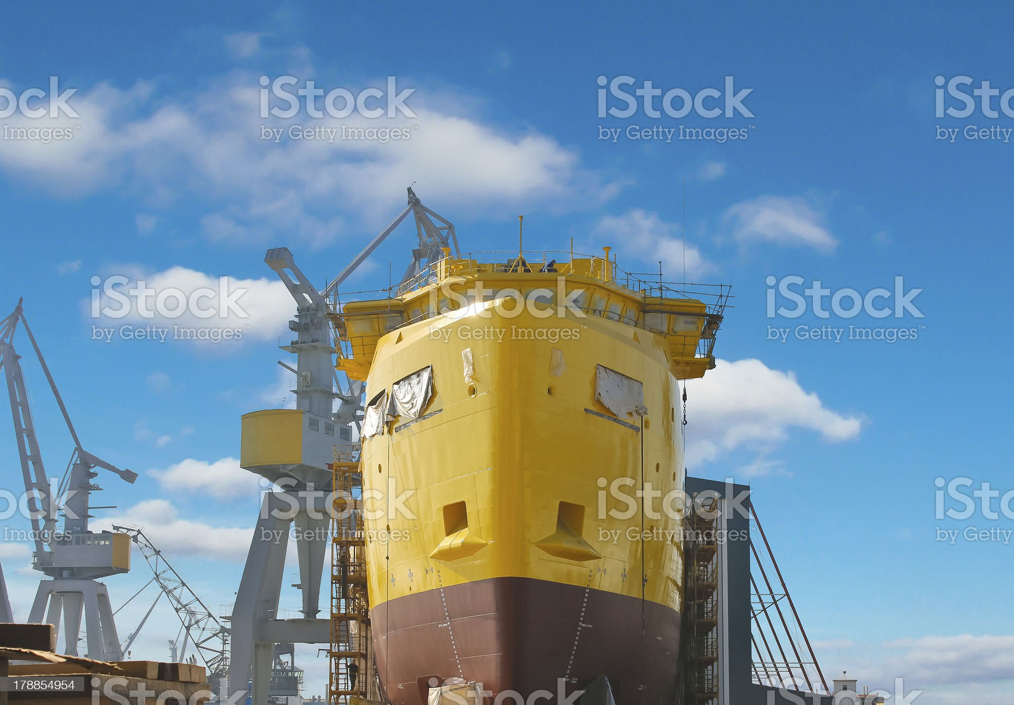 The construction of a new ship in dry dock shipyard royalty-free stock photo