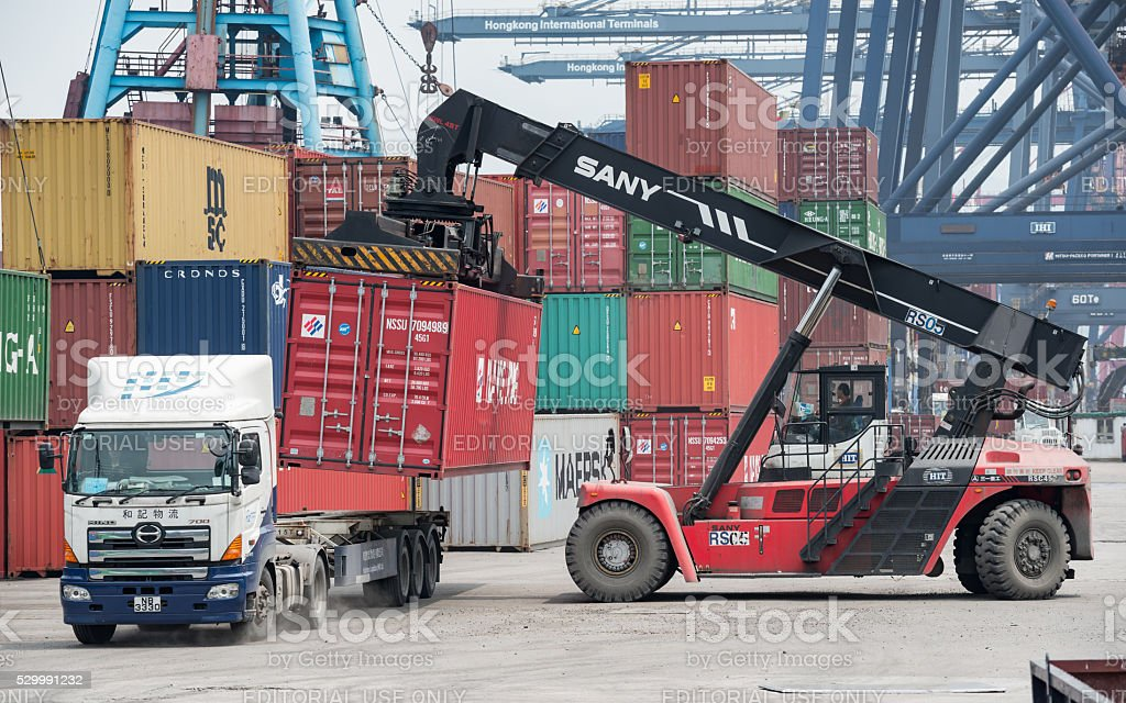 The container is loaded / unloaded at Container Terminals stock photo