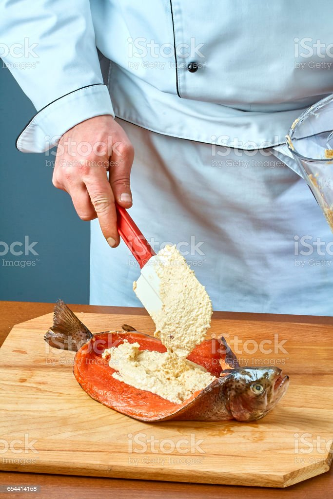 The cook is stuffing fish full of food recipes stock photo