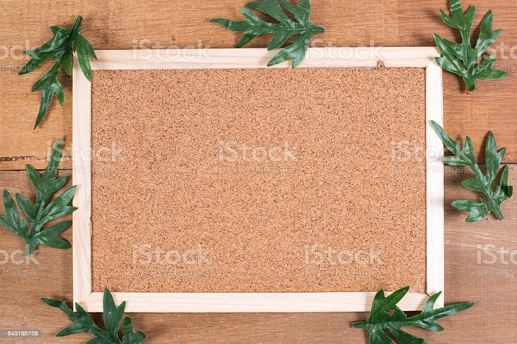 The cork board on the plank wood stock photo