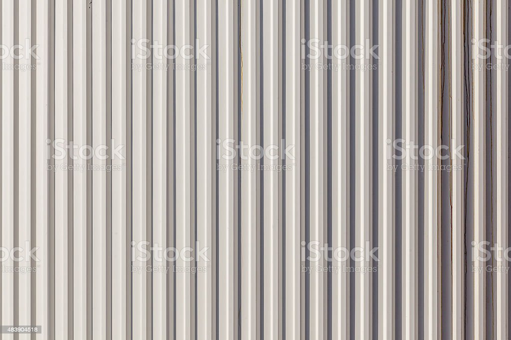 The corrugated grey metal wall background. stock photo